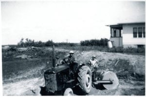 John and Bill Trawin working the land with an old tractor